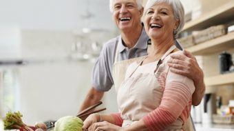 Shot of an ecstatic senior couple laughing in the kitchen