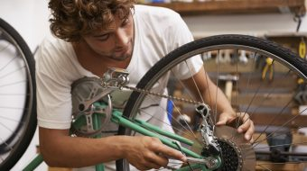 Cropped shot of a young man working on a bicyclehttp://195.154.178.81/DATA/i_collage/pi/shoots/783340.jpg
